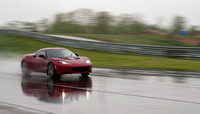 Evora S in the wet at speed